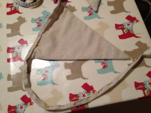 Pinned binding to triangles ready for handstitching