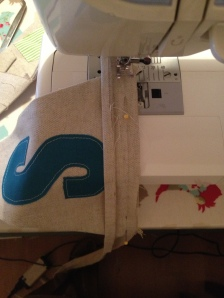 Stitching the binding onto the triangle